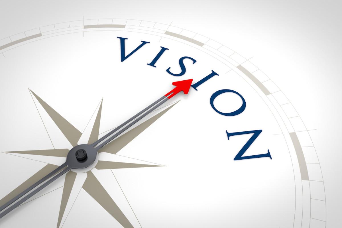 An image of a nice blue compass with the word Vision